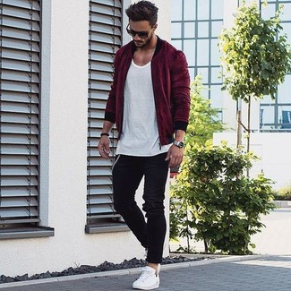 How to wear: burgundy bomber jacket, white crew-neck t-shirt, black jeans, white low top sneakers