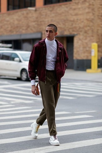 Men's Looks & Outfits: What To Wear In Spring: If you're looking for an off-duty and at the same time seriously stylish getup, rock a burgundy bomber jacket with olive chinos. Add a confident kick to the outfit with a pair of white leather casual boots. Keep this combo ready to go when spring arrives, and we promise you'll save time crafting an outfit on more than one morning.