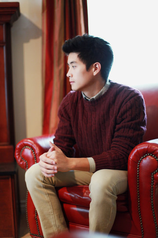 How to wear: burgundy cable sweater, grey vertical striped long sleeve shirt, khaki jeans