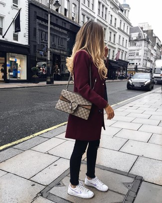 If it's comfort and functionality that you're seeking in an outfit, choose a burgundy coat and black skinny jeans. A good pair of white leather low top sneakers are sure to leave the kind of impression you want to give. As you imagine, this is also a cool option come spring.