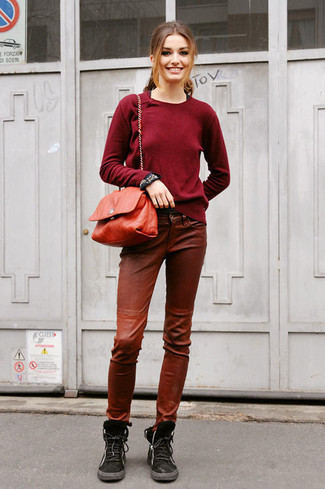 How to wear: burgundy crew-neck sweater, brown leather skinny pants, black suede lace-up flat boots, red leather crossbody bag