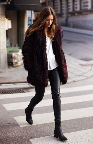How to wear: burgundy fur coat, white crew-neck t-shirt, black leather leggings, black leather ankle boots
