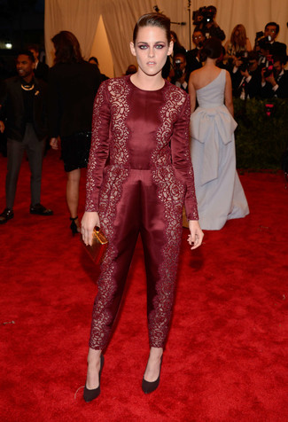 Kristen Stewart wearing Burgundy Lace Jumpsuit, Burgundy Suede Pumps, Gold Clutch