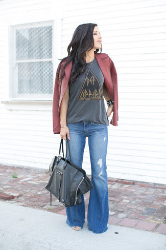 A burgundy leather biker jacket and blue flare jeans are great staples that will integrate perfectly within your current looks. When it comes to dressing for awkward transition weather, nothing beats a knockout combo that will keep you warm and looking your best.
