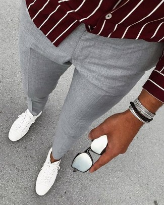 How to wear: burgundy vertical striped long sleeve shirt, grey dress pants, white leather low top sneakers, silver bracelet