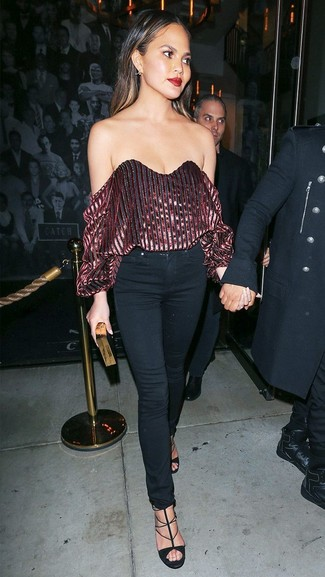 How to wear: burgundy velvet off shoulder top, black skinny jeans, black suede heeled sandals, black and gold clutch