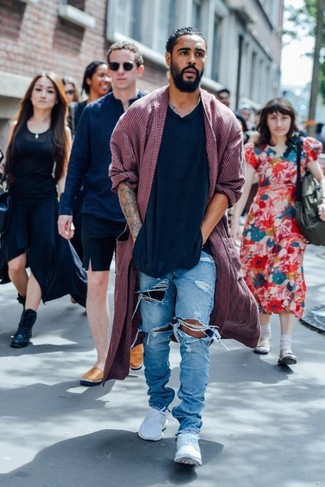 How to wear: burgundy overcoat, black v-neck sweater, light blue ripped jeans, white low top sneakers