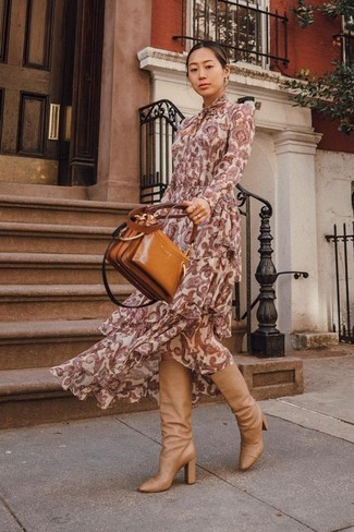 How to Wear Tan Leather Knee High Boots: Dial it down a notch in this comfy combination of a burgundy paisley maxi dress. Switch up this ensemble with a classier kind of shoes, such as this pair of tan leather knee high boots.