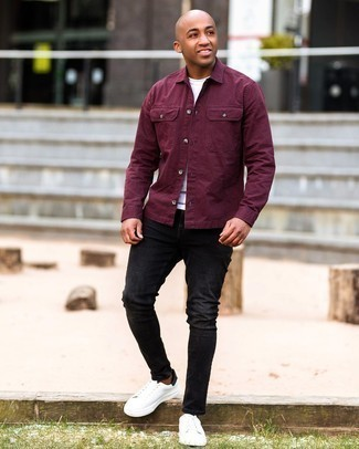 Men's Outfits 2020: A burgundy shirt jacket and black ripped skinny jeans make for the ultimate laid-back look for today's man. A trendy pair of white and black leather low top sneakers is the most effective way to punch up your look.