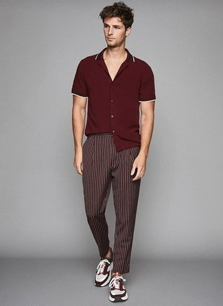 How to Wear Multi colored Athletic Shoes For Men: This off-duty combo of a burgundy short sleeve shirt and burgundy vertical striped chinos is extremely easy to put together in no time flat, helping you look amazing and ready for anything without spending too much time rummaging through your wardrobe. Bring a playful vibe to with a pair of multi colored athletic shoes.