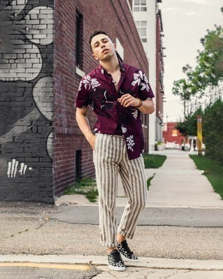 White Vertical Striped Chinos Outfits: When the setting permits a casual ensemble, you can easily rock a burgundy floral short sleeve shirt and white vertical striped chinos. All you need is a good pair of black and white print canvas low top sneakers to complete your look.