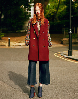 How to Wear a Burgundy Sleeveless Coat: Look chic yet off-duty in a burgundy sleeveless coat and navy denim culottes. If you need to immediately step up this outfit with a pair of shoes, why not finish off with navy denim ankle boots?