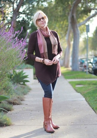 How to wear: burgundy tunic, navy skinny jeans, tan leather knee high boots, pink scarf