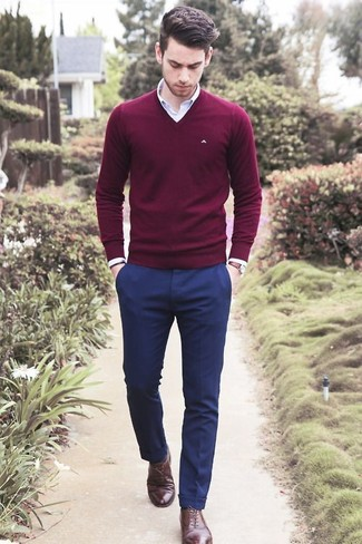 Consider wearing an oxblood v-neck pullover and navy suit pants to ooze class and sophistication. Elevate this ensemble with oxford shoes.