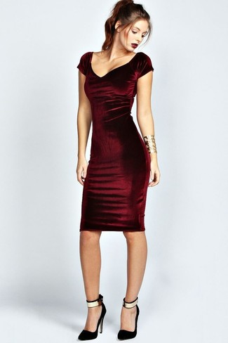 A burgundy bodycon dress will give off this very sexy and chic vibe. For footwear go down the classic route with black and gold suede pumps.