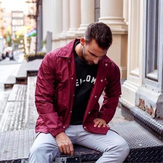 How to wear: burgundy windbreaker, black and white print crew-neck t-shirt, grey chinos
