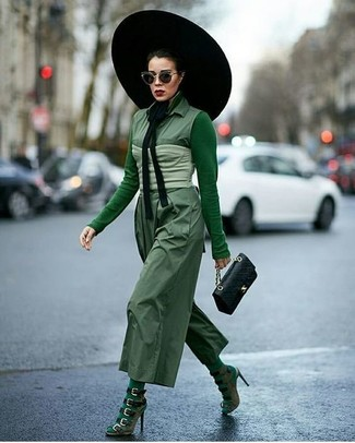 A green long sleeve t-shirt and a green jumpsuit is a nice combination worth integrating into your wardrobe. Kick up the cool of your getup by completing it with olive suede heeled sandals. You're sure to always look absolutely chic even despite the oppressive heat if you keep this ensemble as your go-to formula.