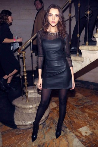 How to wear: black leather bustier top, black mesh long sleeve t-shirt, black leather mini skirt, black leather ankle boots