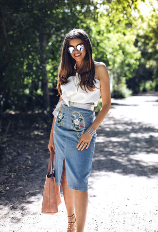 A white bustier top and a blue embroidered denim pencil skirt are perfect for both running errands and a night out. Khaki studded leather heeled sandals are a great choice to complete the look.