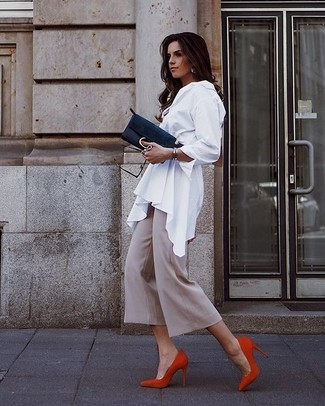 How to wear: white button down blouse, beige culottes, red suede pumps, black suede clutch