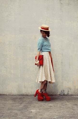 A baby blue button front blouse and a beige lace full skirt is a nice combination to add to your styling repertoire. Round off this look with red suede booties.