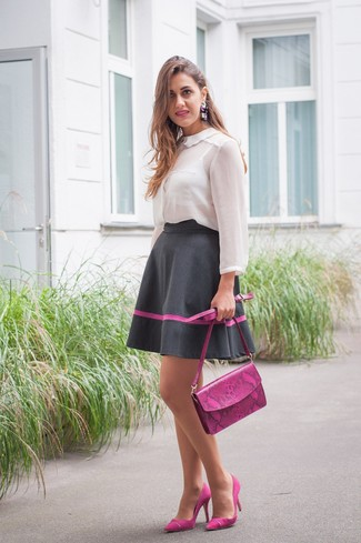 Consider teaming a white chiffon button down blouse with a black full skirt to achieve a chic look. Finish off your look with purple suede pumps.