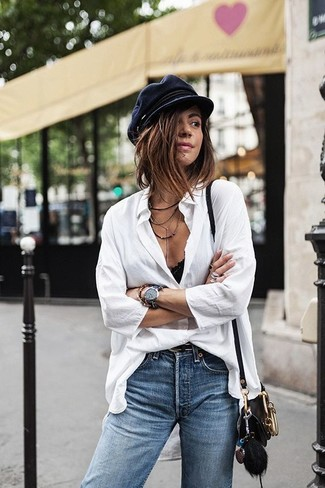 How to wear: white button down blouse, blue jeans, black leather crossbody bag, black flat cap