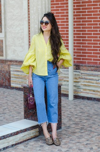 How to wear: yellow vertical striped button down blouse, blue jeans, brown snake leather loafers, dark purple leather handbag