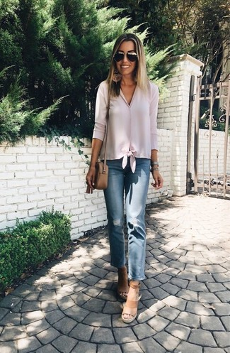 How to wear: pink button down blouse, blue ripped jeans, tan leather wedge sandals, tan leather crossbody bag