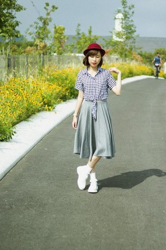 How to wear: white and black gingham button down blouse, grey pleated midi skirt, white athletic shoes, burgundy wool hat