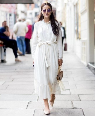 How to Wear a Button Down Blouse: Make a button down blouse and a white silk midi skirt your outfit choice to assemble an interesting and modern-looking outfit. Let your styling credentials truly shine by finishing your getup with a pair of beige leather pumps.