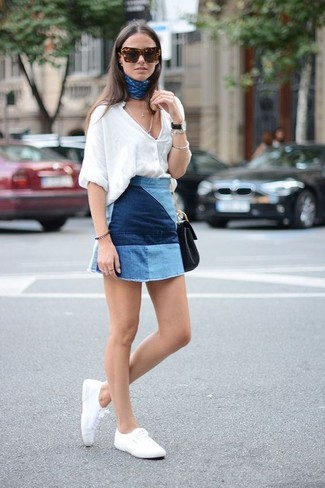 Effortlessly blurring the line between chic and casual, this combination of a white button front blouse and a blue patchwork mini skirt is likely to become one of your favorites. White plimsolls are the right shoes here to get you noticed.