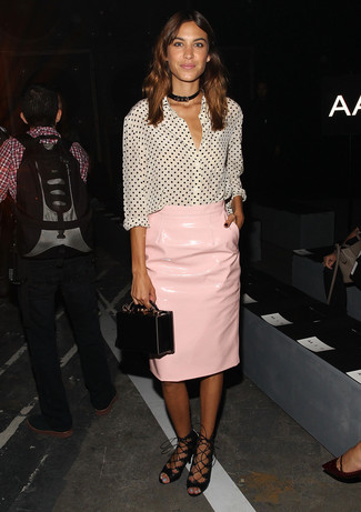 Alexa Chung wearing White and Black Polka Dot Button Down Blouse, Pink Leather Pencil Skirt, Black Leather Gladiator Sandals, Black Leather Clutch