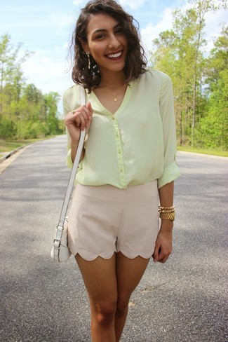 How to wear: yellow chiffon button down blouse, beige silk shorts, white leather crossbody bag, gold watch