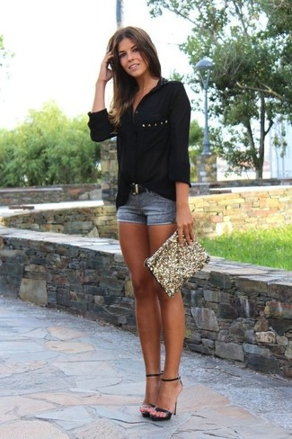 Step up your off-duty look in a black button front blouse and shorts. Black leather heeled sandals complement this look quite well. This look has all the potential to become your summertime go-to.