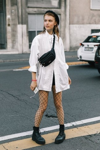 How to wear: white button down blouse, black shorts, black chunky leather lace-up ankle boots, black leather fanny pack