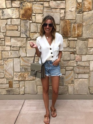 How to wear: white button down blouse, blue denim shorts, brown leather thong sandals, olive print leather crossbody bag