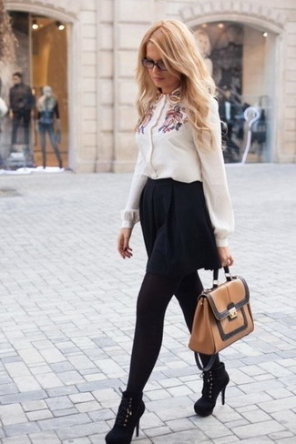 How to wear: white embroidered button down blouse, black skater skirt, black suede ankle boots, tan leather satchel bag