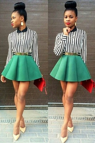 A monochrome vertical striped button front blouse with a green skater skirt has become an essential combo for many style-conscious girls. Rock a pair of yellow leather pumps to kick things up to the next level. Loving how great this one is for unpredictable fall weather.