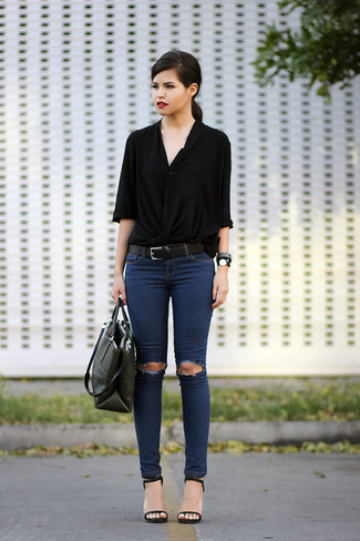 Women's Black Button Down Blouse, Navy Ripped Skinny Jeans, Black Leather Heeled Sandals, Dark Green Leather Tote Bag