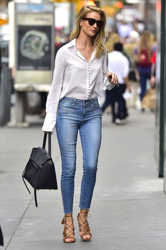 How to wear: white button down blouse, blue skinny jeans, brown suede heeled sandals, black leather satchel bag