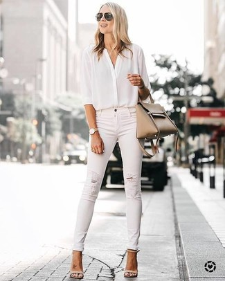 How to Wear Beige Leather Heeled Sandals: A white silk button down blouse and white ripped skinny jeans are the kind of a tested casual ensemble that you so terribly need when you have no time to plan out an ensemble. Go off the beaten track and switch up your ensemble by finishing off with beige leather heeled sandals.