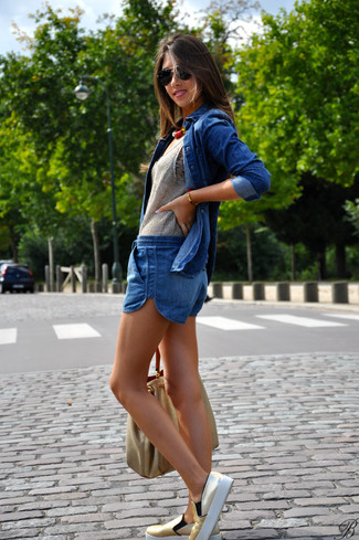 How to wear: blue denim button down blouse, grey knit tank, blue denim shorts, gold slip-on sneakers