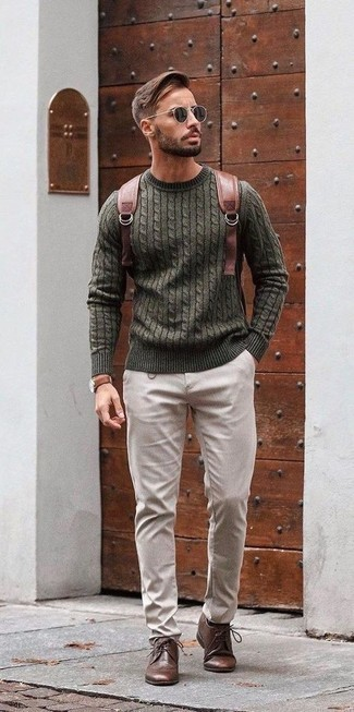 Cable Sweater Outfits For Men: The formula for casual style? A cable sweater with beige chinos. Let's make a bit more effort with shoes and throw dark brown leather brogues in the mix.