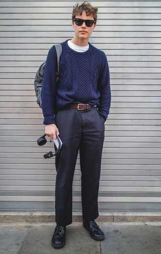 How to Wear a Cable Sweater For Men: Channel your inner men's fashion guru and make a cable sweater and navy dress pants your outfit choice. Ramp up the style factor of this look by finishing with a pair of black leather casual boots.