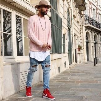 Wear a pink cable sweater and light blue ripped jeans for comfort dressing from head to toe. A pair of red high top sneakers will integrate smoothly within a variety of outfits. We're loving this one, especially for the spring season.