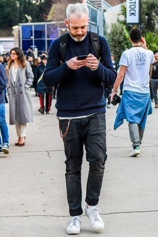 Men's Looks & Outfits: What To Wear In 2020: A navy cable sweater and charcoal ripped jeans are essential menswear pieces, without which no off-duty wardrobe would be complete. Why not introduce a pair of white leather low top sneakers to the mix for an extra touch of polish?