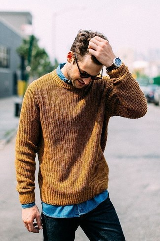 How to wear: mustard cable sweater, blue denim shirt, black jeans, black sunglasses