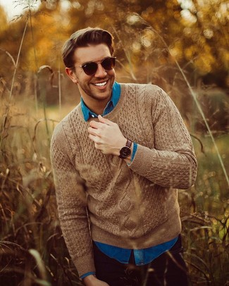 How to wear: brown cable sweater, blue denim shirt, black jeans, dark brown sunglasses