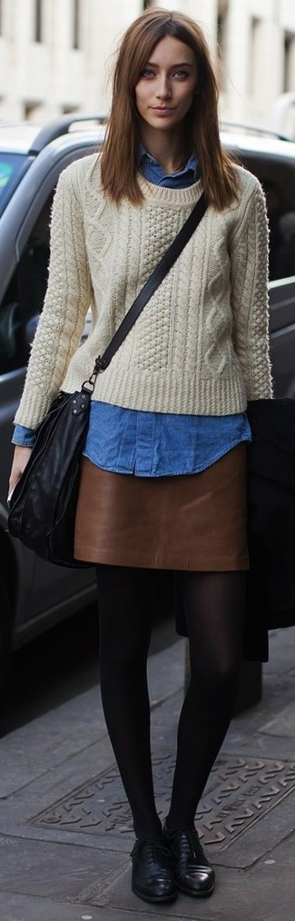 How to wear: beige cable sweater, blue denim shirt, brown leather mini skirt, black leather oxford shoes
